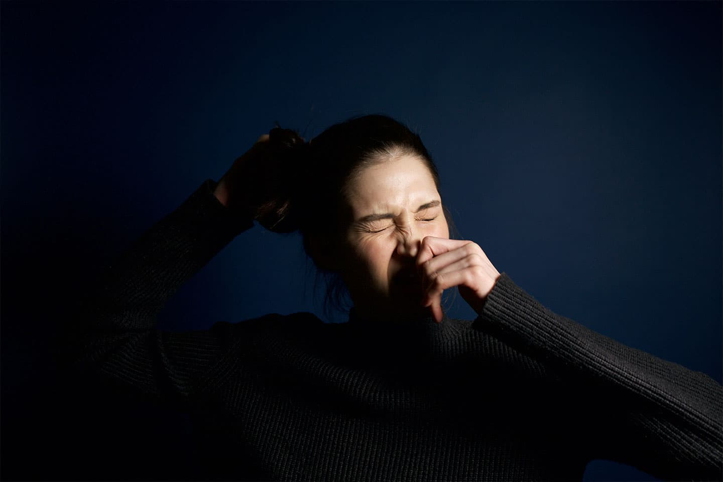 a woman getting ready to sneeze