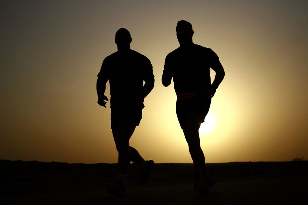 two men running in the sunset