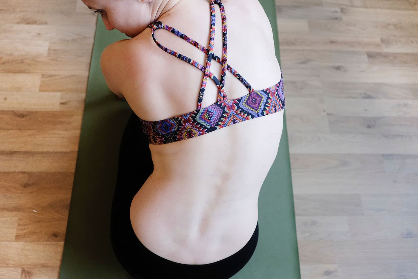 someone sitting down showing a jagged spine