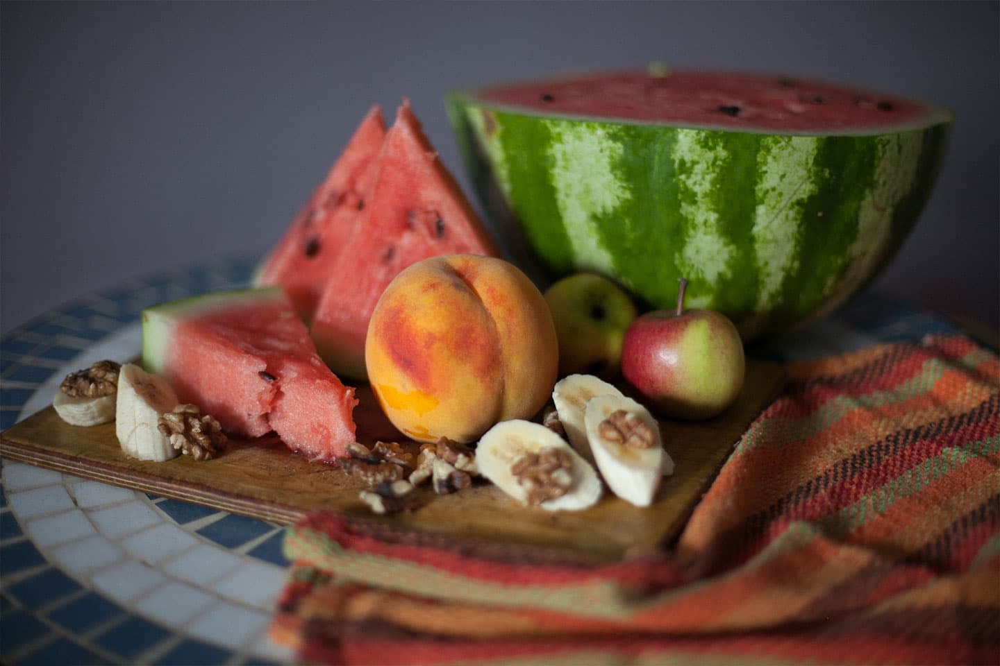 a still life of fruits and nuts