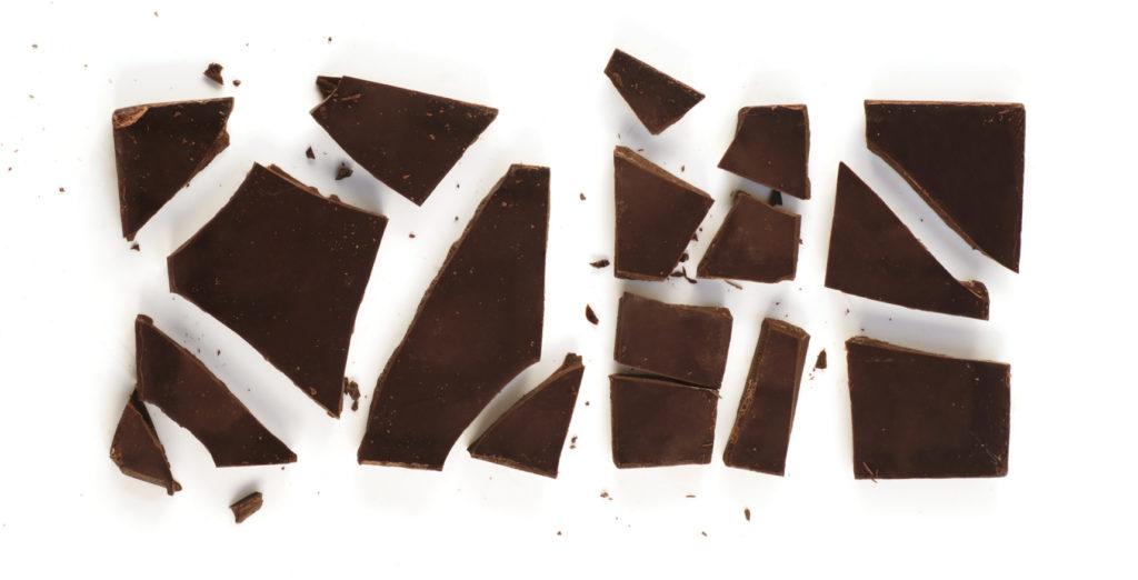 Chocolate bar broken up into pieces.