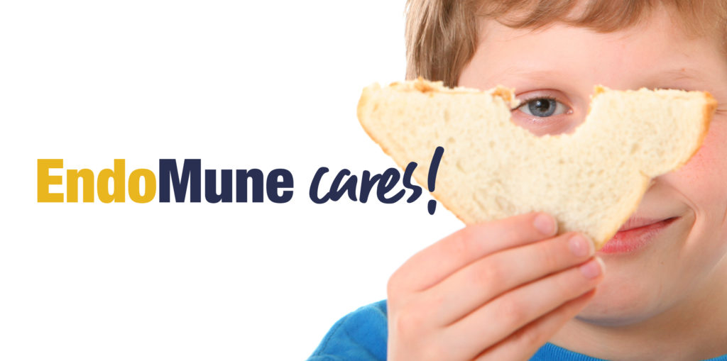 "Young boy holding sandwich in front of his face. Caption is ""EndoMune Cares!"""