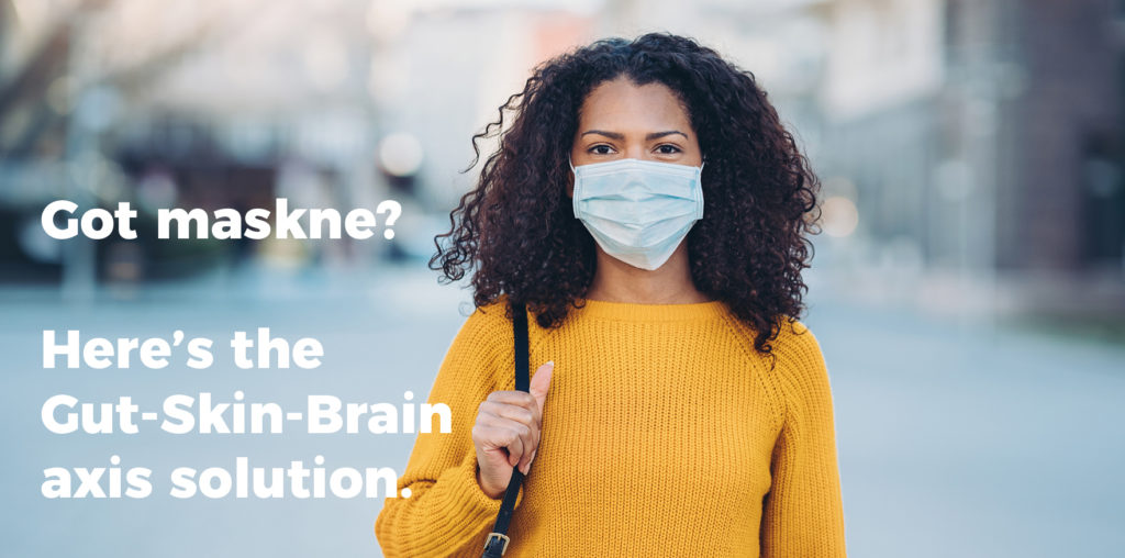 """Woman wearing mask with text on photo """"Got maskne? Here's the Gut-Skin-Brain axis solution"""""""