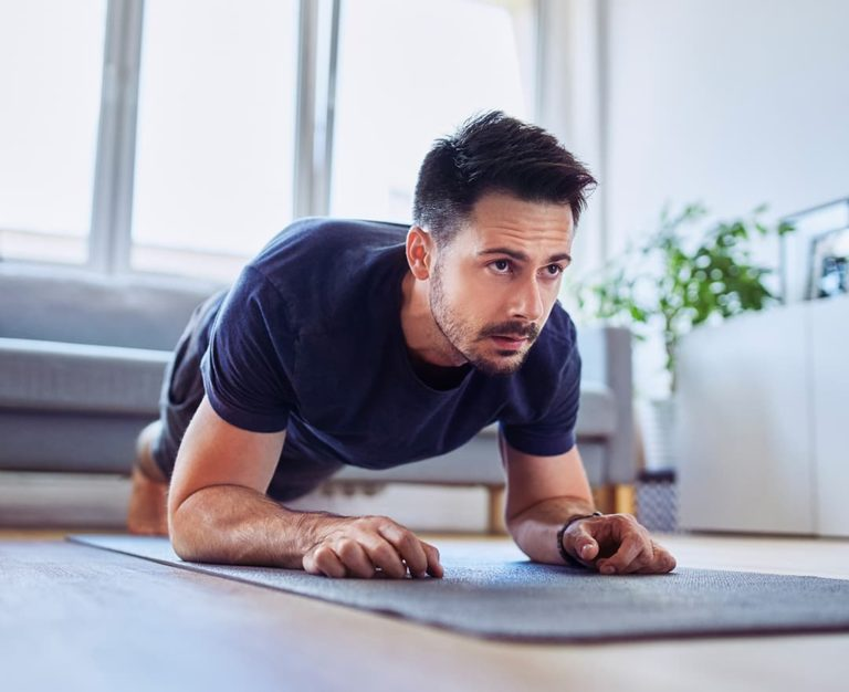 Man doing a plank exercise on a yoga mat