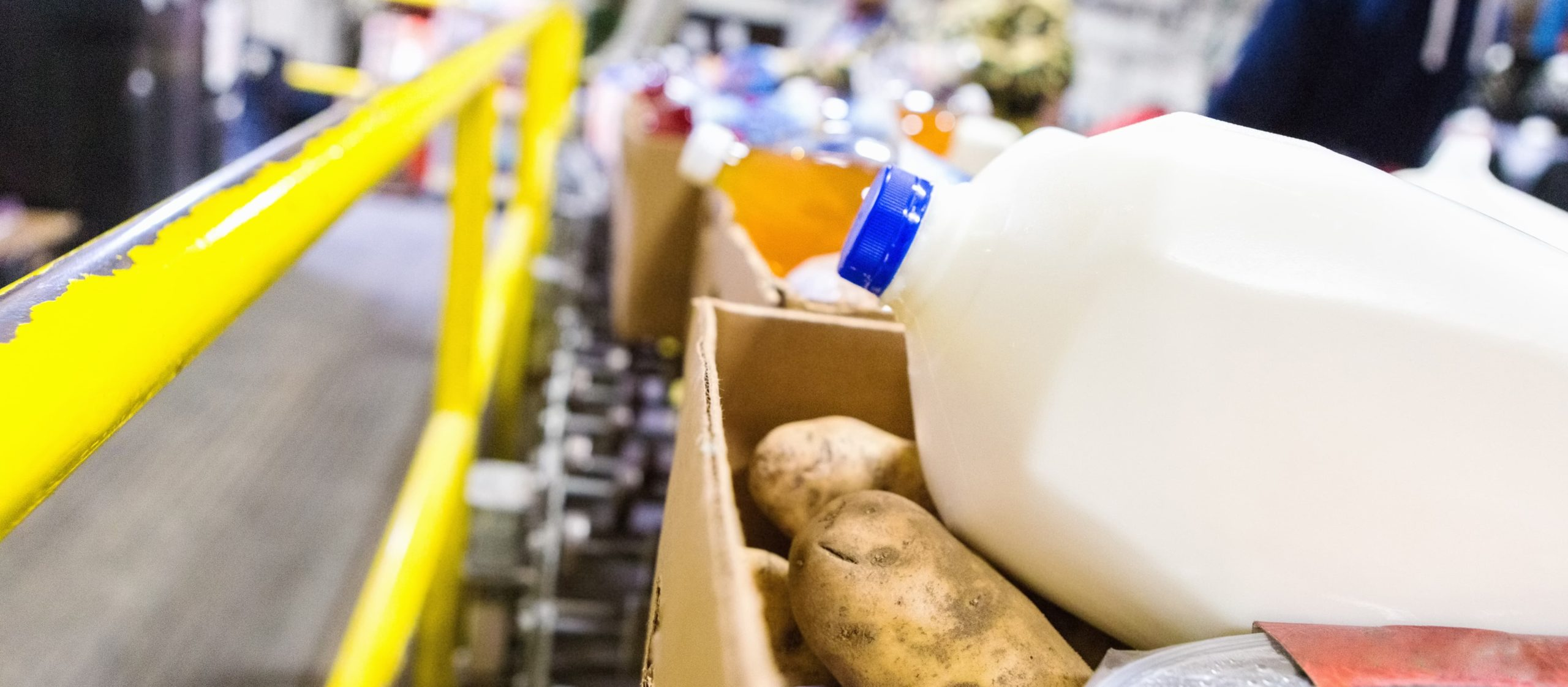 milk and potatoes in a box at feeding America charity