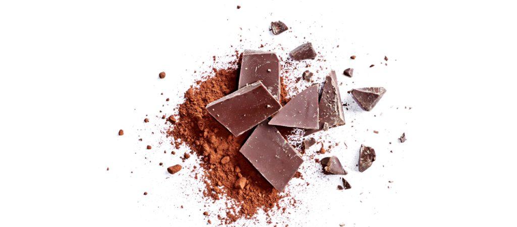 image of broken chocolate bar on white background