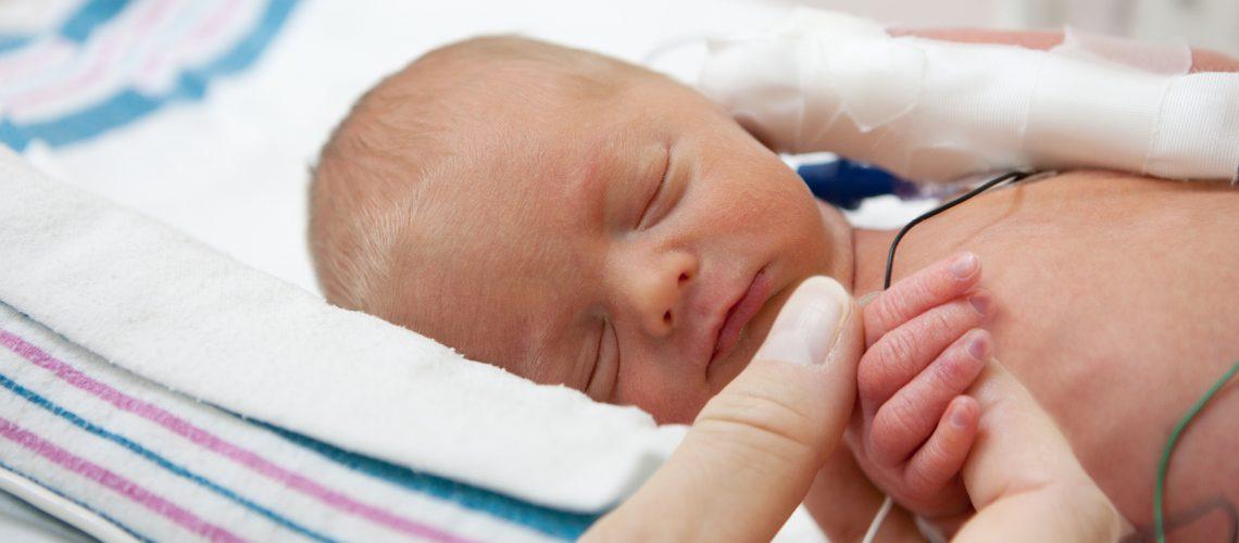 photo of sleeping preemie baby