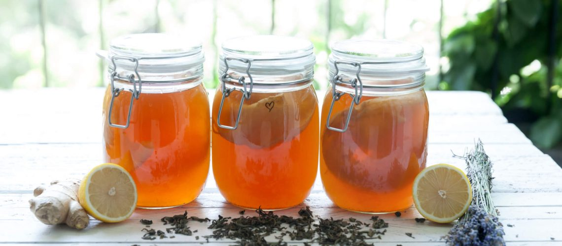 kombucha tea in a mason jar sitting on a table